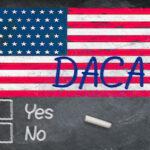 DACA concept using chalk on slate blackboard