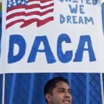 DACA sign above immigrant
